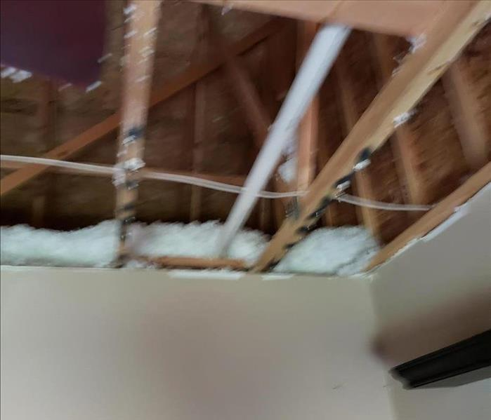 Demo of bedroom ceiling after water damage from a storm
