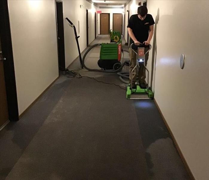 water damage to carpeted hallway of apartment building