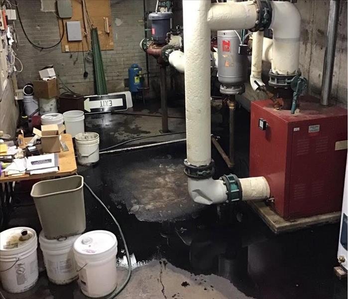water damage in basement of commercial bank