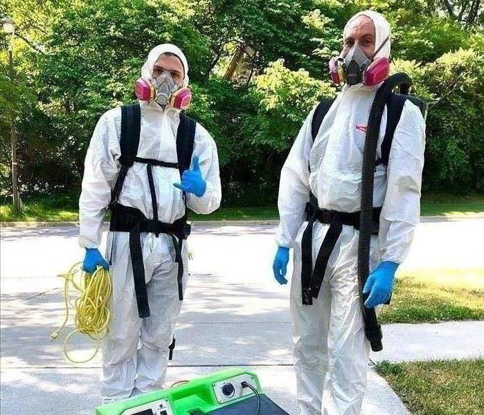 SERVPRO of Ames staff in disinfecting PPE
