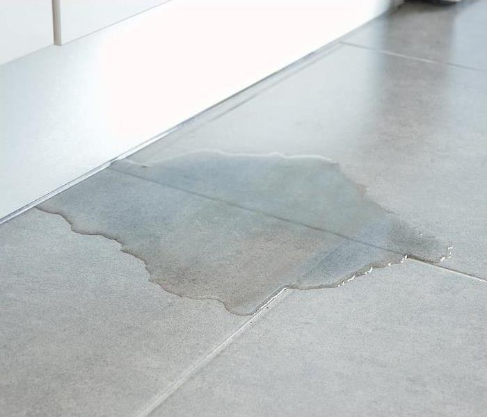 water damage and flooding on kitchen tile